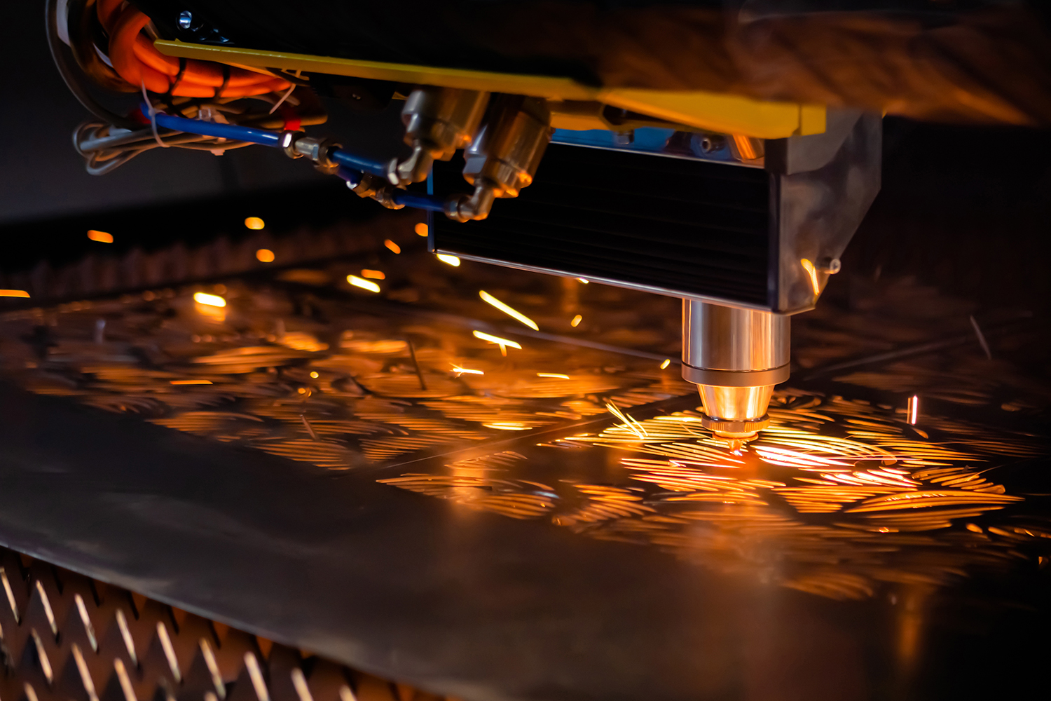 Automatic cnc laser cutting machine working with sheet metal with sparks at factory, plant. Metalworking, industrial, equipment, technology, machining, manufacturing concept